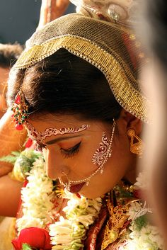 This picture shows the dress that a traditional bride in India would wear. She has the face jewelry, which has been a tradition in India for centuries, and she wears a head scarf that is similar to a veil. Cultures Du Monde, World Cultures, Beautiful Bride, Beautiful People, Beautiful Women, Beautiful Mehndi, We Are The World, People Around The World, Bollywood Stars