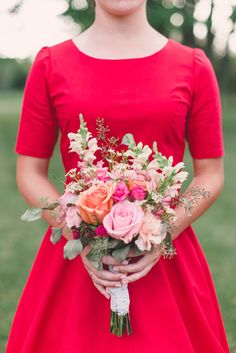 bright bridesmaid bouquet with a mix of roses and greenery #bridesmaids #bouquet #weddingchicks http://www.weddingchicks.com/2014/01/24/pinterest-inspired-vintage-wedding/