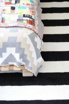 happy habitat kilim throw- a quilt and some stripes! beautiful kids room from simply grove