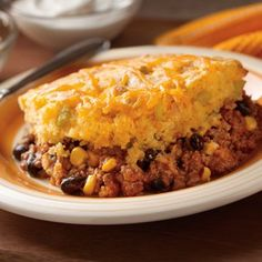 This Chili vs. Cornbread Bake is a unique two-in-one dish that is perfect for group entertaining and would be perfect for fans watching games! Tender golden cornbread with jalapeños blended in meets a Mexican-inspired chili. This is a fun new way to enjoy two favorite recipes in one dish.