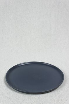 "Ceramic dinner plate finished with a smooth matte glaze. 11.5"" diameter. Microwave and dishwasher safe.  By Felt + Fat - Beam & Anchor"
