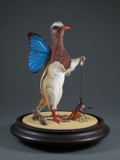 This is simply gorgeous. Bird-butterfly-squirrel walking a pet beetle. By Enrique Gomez De Molina.