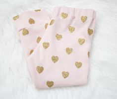 These are made from a soft thick knit, perfect for winter! Sparkly glitter gold hearts are printed all over. The glitter does not shed and it does...
