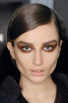 The New Smoky Eye: Autumn/Winter 2013 Beauty Trend (Vogue.com UK)Tom Ford  Tom Ford glamour updated for 2013 - the smouldering winged smoky eyes that Charlotte Tilbury created at the show came in glossy chestnut brown, offset by nude lips.