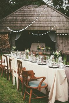 Vintage chairs, farm table, and twinkly lights | Redijus Photography