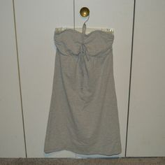 NWOT Hollister Swimsuit  Cover-Up Grey cover up. Knee length dress. Size SMALL. Grey colored halter top. Never worn.  55% cotton 38% polyester 7% roast and  Machine wash cold Tumble dry low Hollister Dresses Mini