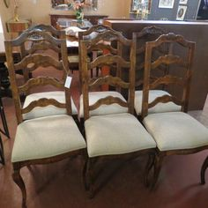 SOLD. $595. vintage set 6 country French chairs. sit in style. ladder back, carved flowers on top. cream linen upholstery. curved legs. excellent condition.