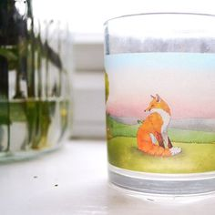 I love the pink and blue skies on my Fox landscape illustration they remind me of warm spring mornings and lazy summer afternoons. Ive been experimenting with printing on glass and making some little candle holders and although its not quite finished and far from perfect it is quite exciting! Hopefully with a bit more work Ill be able to launch a range of glass candle holders with my colourful illustrations soon! Are there any of my designs youd particularly like to see? #abundantapril…
