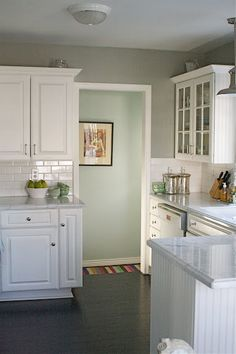 white cabinets, grey walls - clean neutral, easy to change out the splash of color with curtains/towels