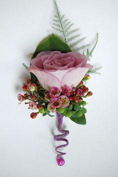 .Corsages 2 cream roses, bracken? berries different perhaps twiddly bit different