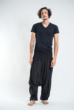 Amazingly soft Solid Color Low Cut Men's Harem Pants in Black.Cotton/Rayon Blend. Free International Shipping on Orders over $60 at HaremPants.com Sizing: One size fits most. Approx. Measurements: Wai