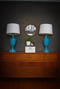 love the contrast, the dark grey walls with ether this color blue or a bright orange. I will avoid wood work, I'm sick of wooden furniture!!!!