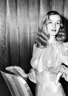Veronica Lake in a publicity in the 1940s super sexy low cut gown cut out satin vintage fashion style movie star glam old hollywood