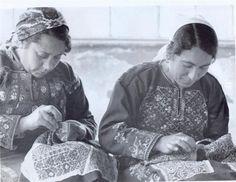 Palestinian women embroidering traditional thobes - tatreez