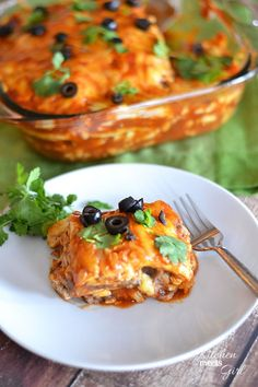 This Cheesy Chicken Enchilada Casserole uses a quick and easy marinade that comes together in a snap, and makes dinnertime a breeze! #recipe...