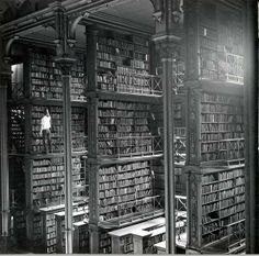 Iconic Historical Photographs From United States. A man taking a book off the shelf in Cincinnati, Ohio, main library in Photo by: Public Library of Cincinnati and Hamilton County. Photos Du, Old Photos, Rare Photos, Vintage Photographs, Vintage Photos, Cincinnati Library, Cincinnati Usa, Detroit Library, Cleveland