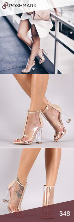 """Nude Transparent Peep Toe Chunky Heel Ankle Boots Nude Transparent Peep Toe Chunky Lucite Heeled Ankle Boots These ankle boots feature a sheer lucite upper with vegan leather trim, stitching accents, peep toe silhouette, and chunky clear heel. Finished with a cushioned insole and rear zipper closure for easy on/off. Material: PVC/Vegan Leather (man-made) Sole: Rubber Measurement Heel Height: 4.35"""" (approx) Shaft Length: 8"""" (including heel) Top Opening Circumference: 9"""" (approx) Shoes Ankle…"""