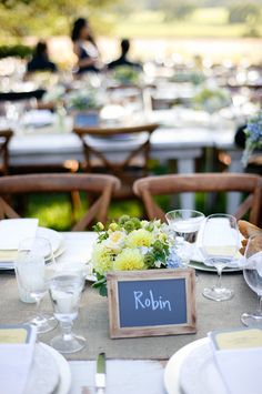 Naming your tables after types of birds or breeds of dogs can be a sweet expression of your love of animals. {39 East Photography}