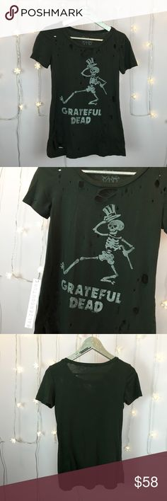 Chaser Grateful Dead Distressed Graphic Tee Rad graphic band t-shirt from Chaser. Popular sold out Grateful Dead skeleton graphic. Super soft and comfy. On trend distressed look. Rarely worn. Perfect condition. Hard to find Chaser piece! Lower offsite. Chaser Tops Tees - Short Sleeve