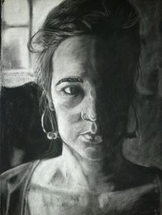 Charcoal self portrait by Cari Griffin