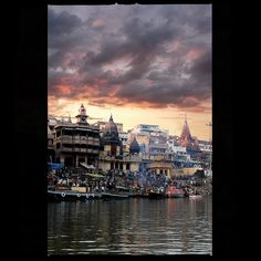 Manikarnika Ghat (मणिकर्णिका घाट) shot from a boat on the Ganges in Varanasi (Benaras), India.  This is the place where one comes face to face with life and death.  Manikarnika Ghat symbolizes mortality of the world and is one of the oldest and most sacred Ghats in Benaras. According to the Hindu mythology, being burned here provides an instant gateway to liberation from the cycle of births and rebirths.
