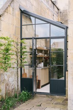 The beautiful Crittall doors that lead into this stylish industrial feeling kitchen. Fitted with Sebastian Cox cupboards and finished with a chunky concrete worktop, this kitchen feels so different and yet still completely inviting and welcoming.