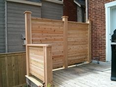 Privacy Screen added to an existing deck made of cedar.