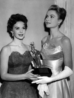 msnataliewood:    Natalie Wood and Grace Kelly accepting an award for James Dean in 1955. He had died on September 30. Natalie looks destroyed.