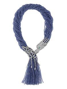 Cartier Dragon-motif tassel necklace. Platinum, tanzanite beads, diamonds.