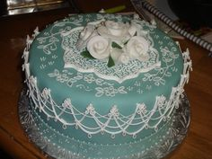 Turquoise stringwork cake from CakeCentral.com by saramachen