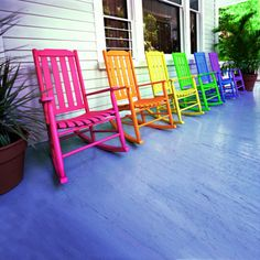 multiple rocking chairs in different hues. Love this...I won't be happy until my yard has more color than Disneyland!