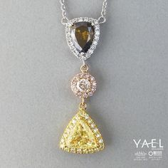 What shall we call our latest natural yellow, brown and pink diamond necklace? #yellowdiamond #pinkdiamond #browndiamond #necklace
