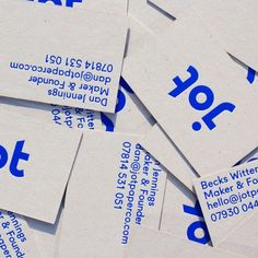 Jot Paper Co. brand identity business card, hand-printed in blue hot-foil on to grey board - repurposed from supplier packaging