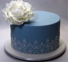 Blue wedding cake  -not into the GIGANTIC flower on it, but I do like the rest of it =)
