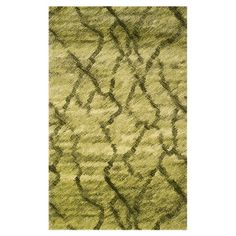 Loomed shag rug.  Product: RugConstruction Material: PolypropyleneColor: Green and dark green