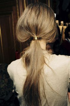 Gold cuffed ponytail