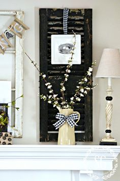Spring mantel decor with flowers, buralp banner and chippy shutters You'll be inspired to bring touches of Spring into your home with these 13 Stylish Spring Mantel Decorating Ideas! Birds, eggs, nests, moss and flowers! Shutter Decor, Diy Shutters, Wooden Shutters, Spring Home Decor, Spring Crafts, Fireplace Mantle, Ladder Decor, Prim Decor, Country Decor