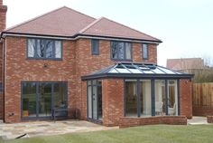 We supply and install structures just like this modern orangery all over the South East. This combined uPVC grey windows in the main house with aluminium. Brick Extension, House Extension Plans, House Extension Design, Extension Ideas, Grey Window Frames, Black Window Trims, House With Grey Windows, House Windows, Black Windows