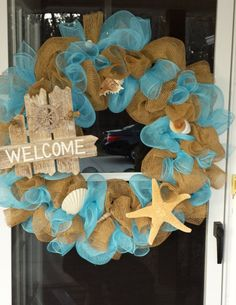 Hand made Beach themed deco mesh wreath with shells and a star fish to give you that beach feeling. on Etsy, $55.00