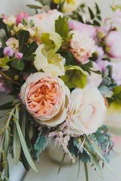 garden rose and eucalyptus floral arrangement - photo by Jason Hales Photography http://ruffledblog.com/romantic-atlanta-wedding-at-summerour