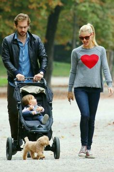 Pregnant Michelle Hunziker with husband Tomaso Trussardi and their daughter Sole take a stroll in the park of Milan, Italy