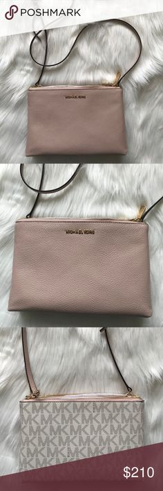 Michael Kors Crossbody Bag NWT Michael Kors Light Pink Crossbody Bag. Pink on one side and MK logo in cream on the other side. 2 zip compartments to separate your things. This cross body bag is adorable for spring Michael Kors Bags Crossbody Bags
