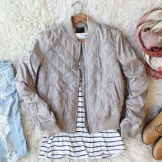 Soft taupe tones adorn this gorgeous bomber jacket. Designed with a soft quilted base, this jacket has a zip-up front, sweet side pockets, and darling bomber fit. Perfect paired with jeans & boots for