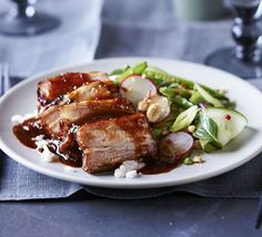 Sticky pork belly with Vietnamese-style salad smashed peanuts. Flavour pork with hoisin, honey, soy and ginger and serve with a crunchy cucumber, radish and herb salad with zesty chilli dressing Bbc Good Food Recipes, Cooking Recipes, Cafe Recipes, Kitchen Recipes, Gourmet Recipes, Pork Salad, Prawn Salad, Sticky Pork, Pork Belly Recipes