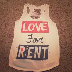 LOVE FOR RENT tank top with cut out back Super cute shirt for summer! White with gray and orange words. The entire back is cut out as if you had used scissors, looks so cool on and with a bando! No stains, worn only a couple times! Forever 21 Tops Tank Tops