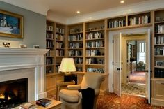 A home library and study is a must in my dream house. Elements represented in this photo that I would choose are the fireplace, comfortable seating, good lighting throughout, shelves starting at thigh high, storage below shelves, and double doors for privacy.