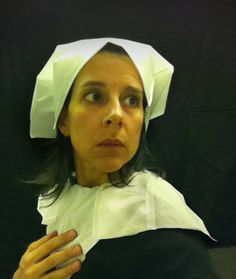 """To pass the time during long flights, artist Nina Katchadourian goes to the lavatory, adorns herself in tissue paper costume, and creates hilarious self-portrait photos in the style of Flemish Renaissance paintings. She calls the series """"Seat Assignment: Lavatory Self-Portraits in the Flemish Style"""