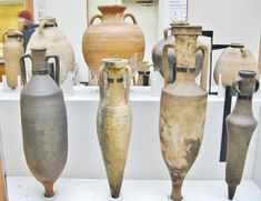 Roman transport amphorae in the British Museum, London. These held wine, olive oil, garum (fish sauce) and other commodities. Those in the front row are, L to R, from Italy, Spain, Italy again and Egypt, 1st Century BC through 2nd Century AD. Those behind range from Turkey, Greece, Spain and Italy and in date from the 2nd Century BC through 6th Century AD. Photo Credit: Clio Ancient Art and Clio Ancient Art & Antiquities