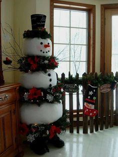 DIY snowman stuff felt sacks, or pillowcases and stack wreaths and sacks add top hat, boots and some pompoms for buttons and face.
