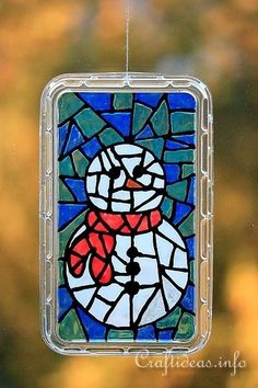 Wow, this Faux Stained Glass Snowman is so COOL!! Learn how to make it!